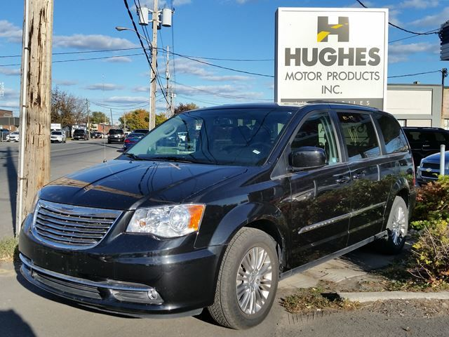 Only 40,000KM, this 7 passenger 2016 Chrysler Town & Country mini van is ready to carry the entire team. Leather interior, heated front seats (with passenger power), 2nd row bucket seats, 3rd row bench seating, privacy glass, back-up camera, roof rack, complete power package including sliding doors and liftgate, cruise control, alloy wheels, fog lamps, A/C, AM/FM/CD Player, 6 cylinder, ABS brakes, front wheel drive and more. Hughes Motor Products | 416-252-1100