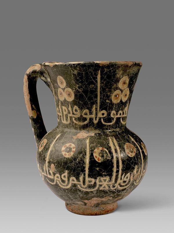 "Slip Painted Calligraphic Jug - ADC.110 Origin: Central Asia Circa: 10 th Century AD to 11 th Century AD Dimensions: 6.50"" (16.5cm) high ..."