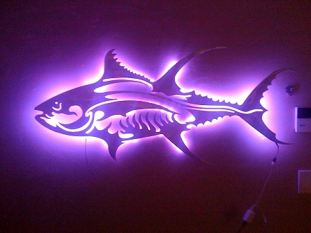 5052 aluminum Tuna sculpture, will never rust and can be displayed inside or outside.  Backlit with remote LED lighting.