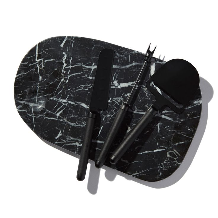 Check out Matte Black Cheese Knife Set at goop.com!'