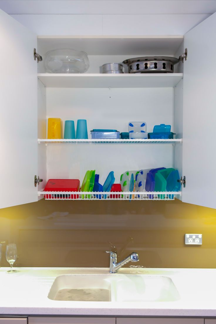Practical Kitchen Needs. A Dish Drying Rack inside the cupboard.