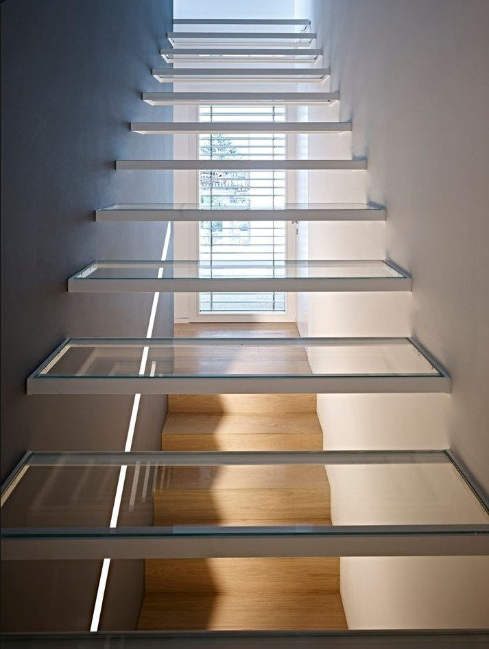 Floating Glass Stair Treads Give A Sense Of Openness And Style