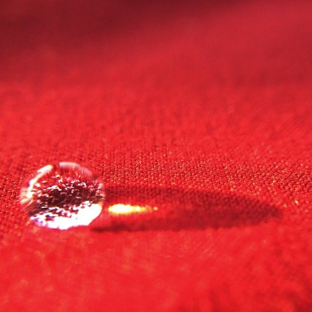 A #drop of #water on a red tablecloth casts a #shadow and a creates a #highlight from the setting #sun. I love how this clear liquid can act like a magnifier to intensify the light and also block the light at the same time. Image captured on an #iphone5s using a #Gizmon #macro lens and unedited.