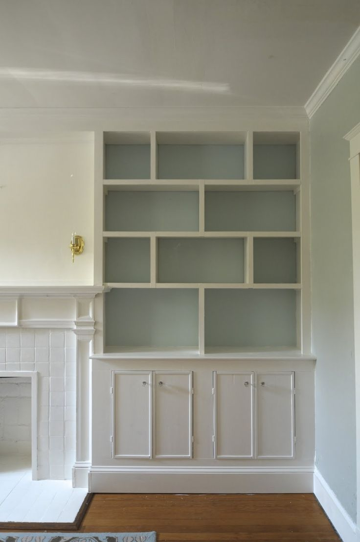 TIDEWATER by Sherman Williams - paint in back of shelves. Like uneven shelving and detail on front of cabinets.