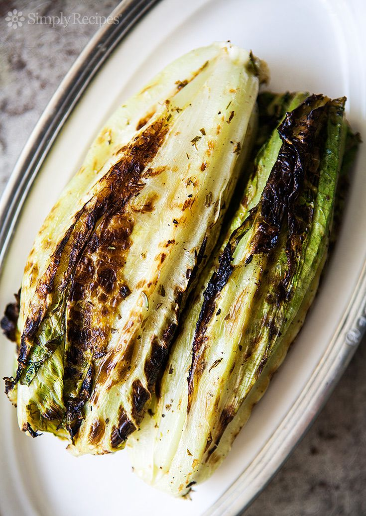 Grilled Romaine Lettuce ~ Hearts of romaine lettuce, painted with a herb vinaigrette, and grilled. Served whole, or chopped for a grilled salad. ~ SimplyRecipes.com