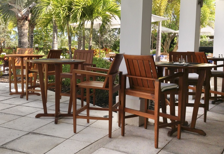 teak high top patio tables and chairs at an outdoor