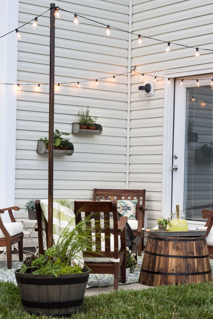 Clever way to have the supports necessary for those super cute white patio lights...