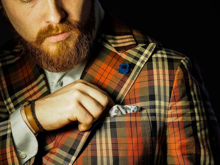 Red jacket, beard and pocket square