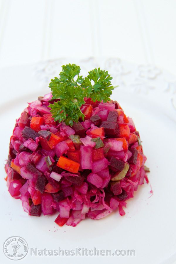 "This is another ""staple"" of Russian/ Ukrainian cooking. Its also a very pretty & vibrant Russian salad. I think every Ukrainian person has either made it or tried it. My sis tells me that canned beets taste just as good in Russian cooking and it reduces the hassle and..."