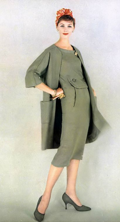 1958 Lucinda in green linen chemise dress with its matching loose linen coat worn with color-print back of the head turban, all by Christian Dior-New York