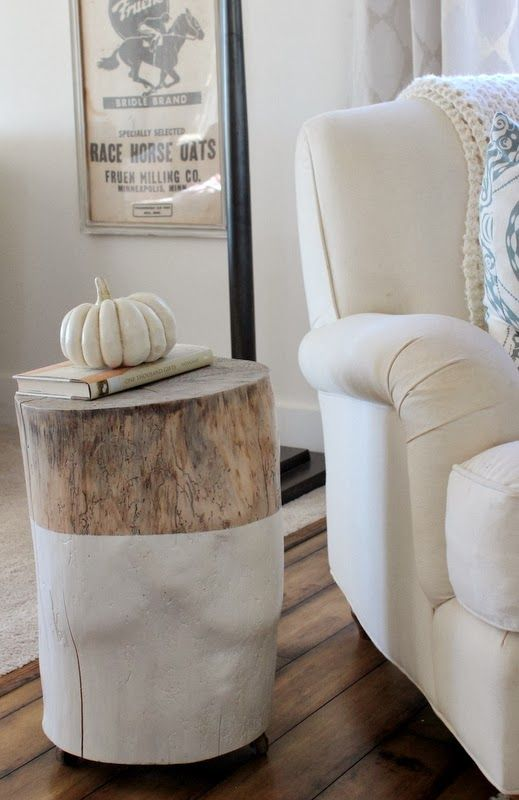 Tree stump side table: tree trunk section, white paint on half, casters. LOVE