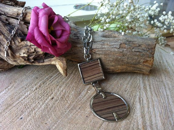 Wooden pendant on metal chain necklace