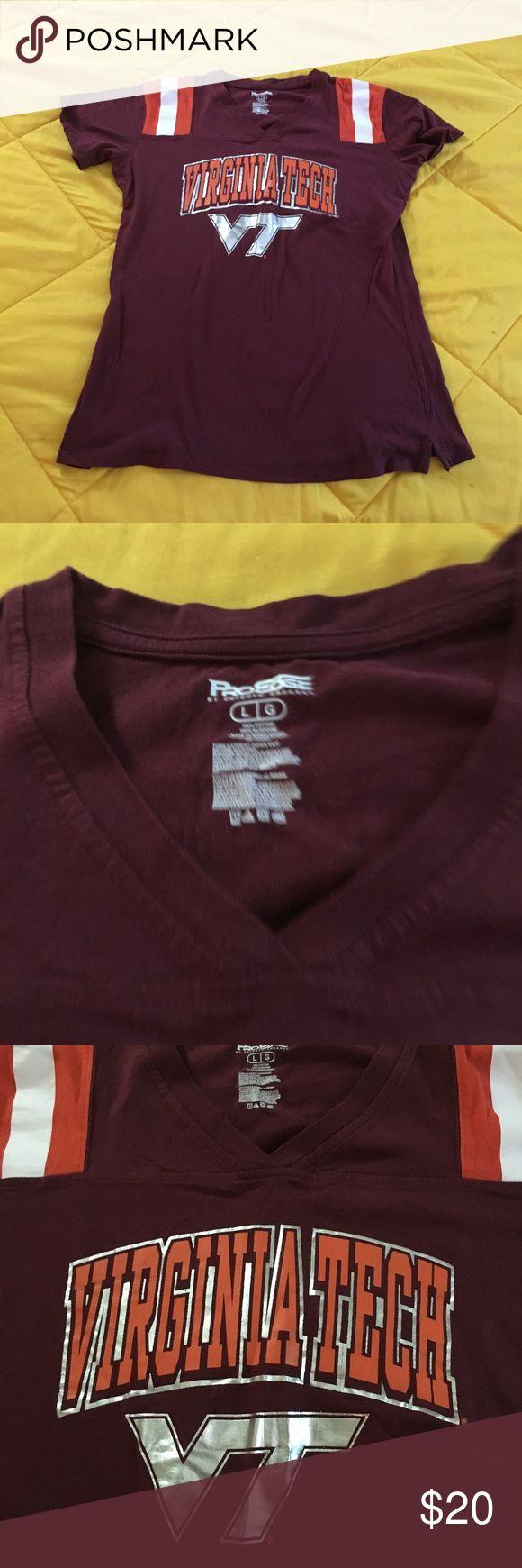 Women's/Juniors Virginia Tech Tshirt  large Women's/juniors Virginia Tech Tshirt. Size large. GUC. Maroon base with silver & orange writing. White & orange stripes on shoulders. Tops Tees - Short Sleeve