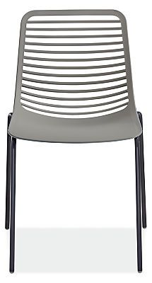 Get distinctive design and all-day comfort with the modern Mini chair. This versatile outdoor dining chair is crafted from durable, fiberglass reinforced nylon with a powder-coated steel base for lasting durability in the elements. Its sleek, smart design allows for stackable storage and easily holds up to daily use. This commercially rated outdoor chair is exclusive to Room & Board in the U.S.
