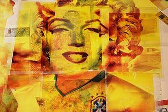 """A Marilyn Monroe é um dos destaques da exposição que inaugura nesta sexta-deira, 11, na galeria Area Artis. A mostra """"Copa Arte"""" traz uma imagem da atriz vestida com a camisa da seleção de futebol brasileira. A ideia é exibir obras que tenham como tema o esporte."""