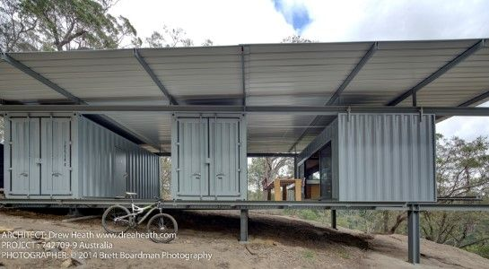 Shipping Container Home Retreat. Just think of all the solar panels you could fit up there.