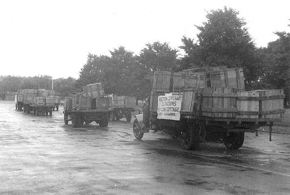 Transporting crates of the dismantled Captain Cooks' Cottage through Melbourne. 14/4/1934 prior to rebuilding it in the Fitzroy Gardens. It was originally built in the village of Great Ayton in Yorkshire, England in 1755, by Cook's parents. Melbourne philanthropist, Russell Grimwade purchase the cottage as a centenary gift for the people of Melbourne. The cottage had to be dismantled, each brick numbered, put into 253 cases and 40 barrels crates and shipped to Melbourne.