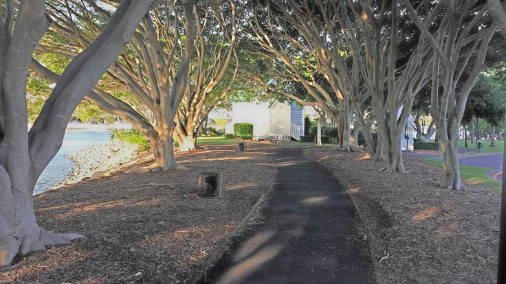 A tree lined riverside path leads to St Margaret's Church a popular wedding location.