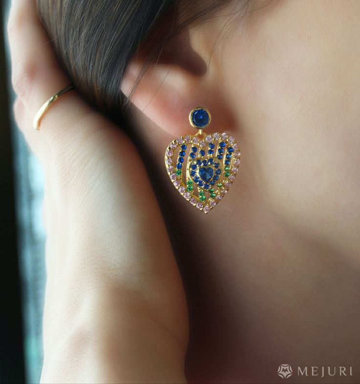 Fine designed earring looks wonderful when teamed with the single finger ring.