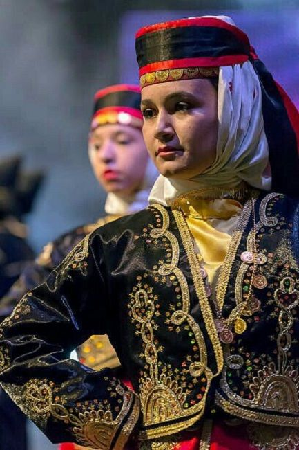 A traditional festive costume from the Artvin area.  Style: 1925-1950.  This is a recent workshop-made copy, as worn by folk dance groups.