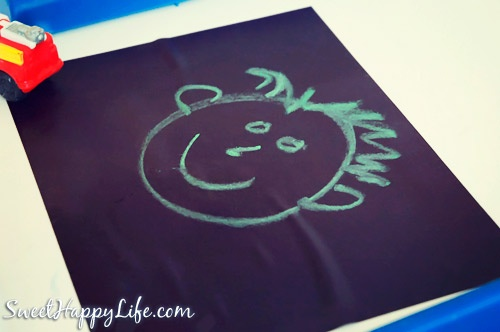 Fun with Sidewalk Chalk in the Winter - Indoor Toddler Activity....wet black construction paper and the chalk works great