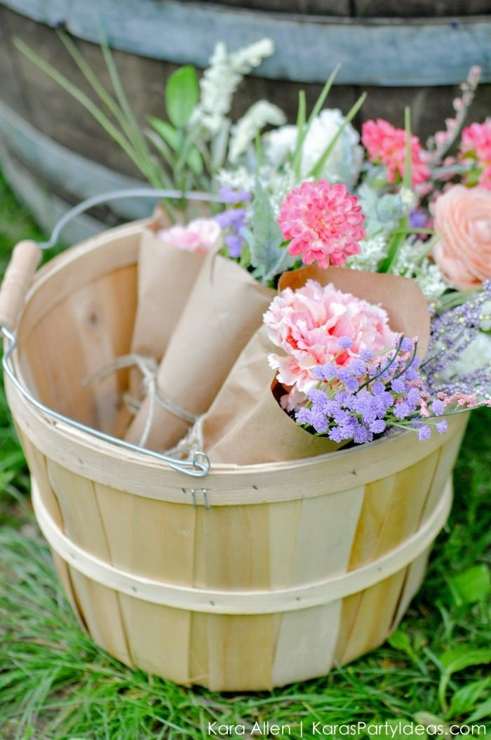 Love these flowers wrapped in Kraft paper! Picnic in the Park by Kara Allen | Kara's Party Ideas in NYC New York City Central Park