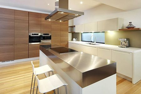Poliform Residential Project - Minimal Kitchen with integrated handle and seamless joinery &  flawless surfaces that combine stone and stainless steel benchtops, a ceramic hob, and integrated cabinetry, complemented by the large island bench. www.poliform.com.au #design #interior #kitchen