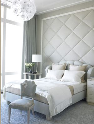 An entire wall has been upholstered and then the luxury has been doubled by placing an upholstered headboard in front of it! I'll bet that this bedroom is whisper quiet because of all the fabric which helps to deaden noise.