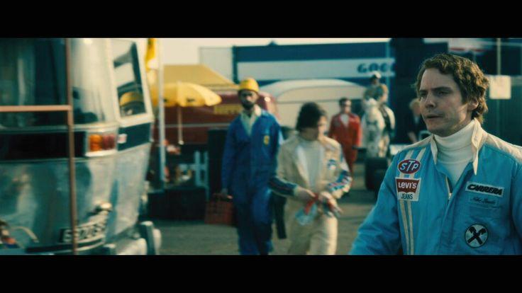 Rush the Scuderia Ferrari Estafette in backshot as 'Niki Lauda' walks across camera.