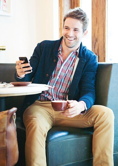 Shop this look for $79: http://lookastic.com/men/looks/chinos-and-navy-shawl-cardigan-and-red-longsleeve-shirt-and-tobacco-chinos/764 — Navy Shawl Cardigan — Red Plaid Longsleeve Shirt — Tobacco Chinos