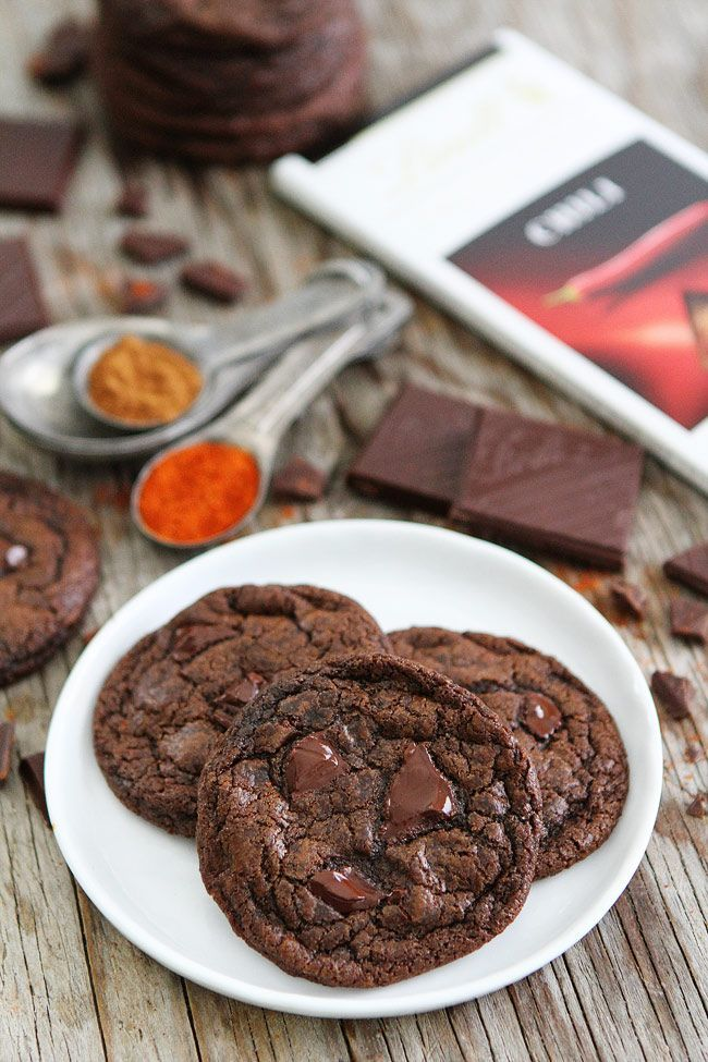 Dark Chocolate Chili Cookie Recipe on twopeasandtheirpod.com Rich chocolate cookies with a hint of cinnamon, cayenne pepper, and chili chocolate. I love the spicy kick that comes at the end!