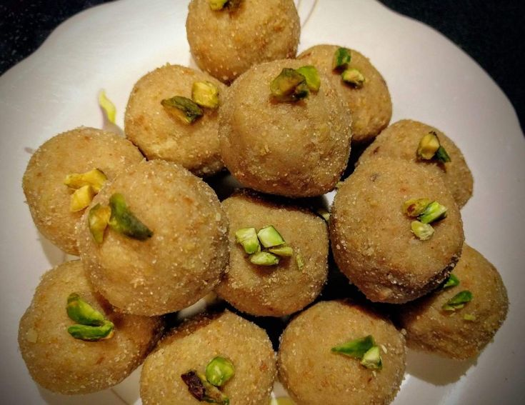Churma Ladoo is a famous rajasthani sweet made by rolling churma made from whole wheat flour into balls. These are often served along with Dal & Bati.