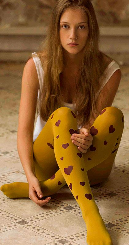 Add a splash of romance to your wardrobe with these Hearts Print Tights by Zohara