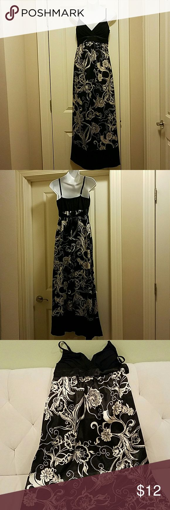 Silky black and white floral maxi dress Black and grey floral maxi dress.  Tie in the back and bra cups in the front for support. Only worn once for a wedding. The perfect wedding guest dress! Trixxi Dresses Maxi