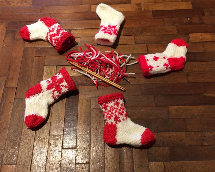 Mini Christmas knitted stockings, sewn up and ready for the tree.