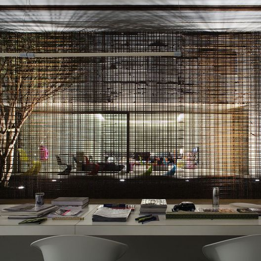 Built by Marcio Kogan in Sao Paulo, Brazil with date 2006. Images by Fran Parente. This project is the retail furniture store Vitra located in São Paulo.   We used the materials in their extreme condi...