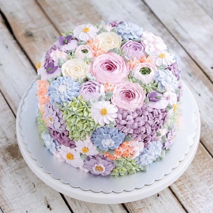 Buttercream wedding cake covered in flowers by Indonesian cake maker @ivenoven