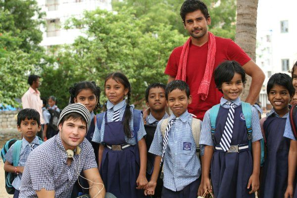 """Cody, and Walid with orphans on the set """"Not Today."""