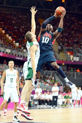 Making it tough - Kobe Bryant tries to shoot over Lithuania forward Paulius Jankunas during the back-and-forth game.