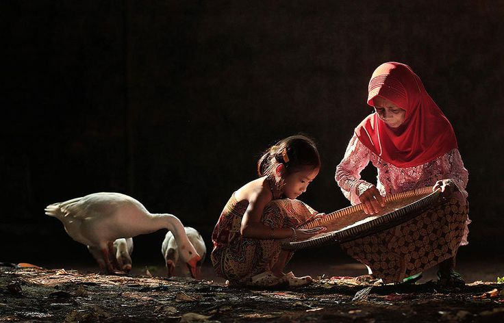 Self-taught landscape and portrait photographer Herman Damar, based in Jakarta, captures everyday life in villages throughout Indonesia.