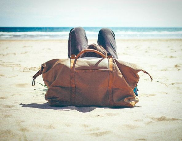 Relaxing at the beach with our amazing duffle bag. #bag #vintage #musthave