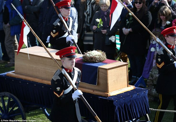 Cadets wheel Richard III's coffin on to the battefield at Bosworth, near Leicester. The bo...