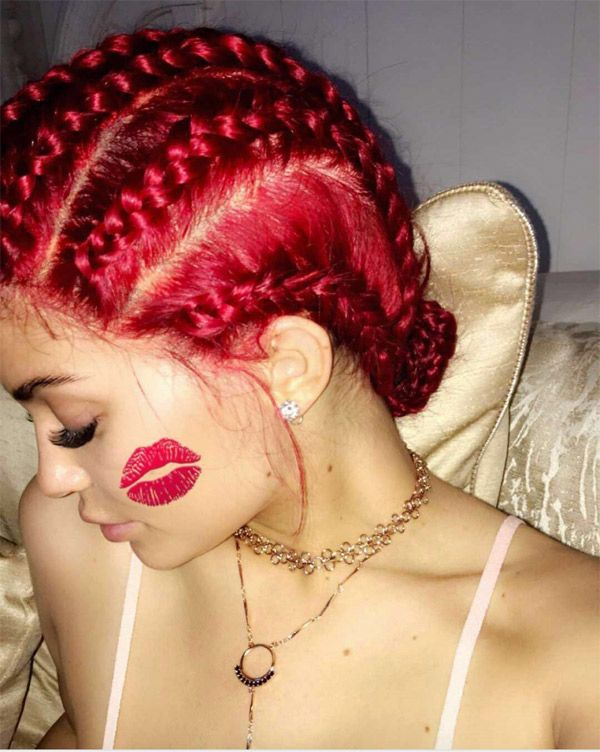 Kylie Jenner rocks a red hot new braided hairstyle!