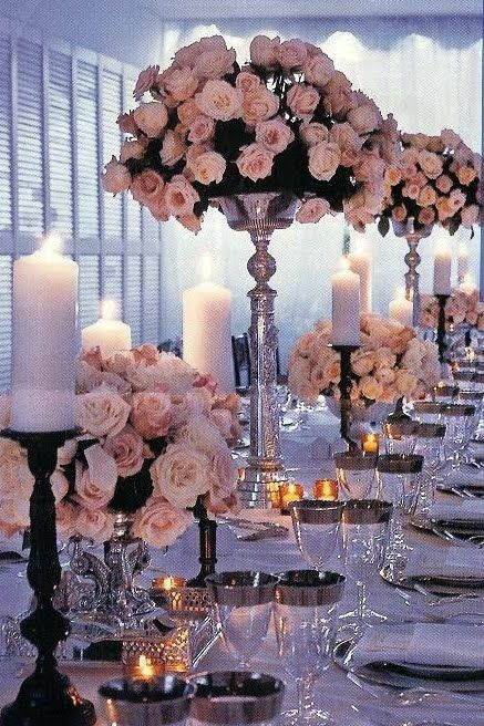 I love this look, I love the trays underneath the arrangements