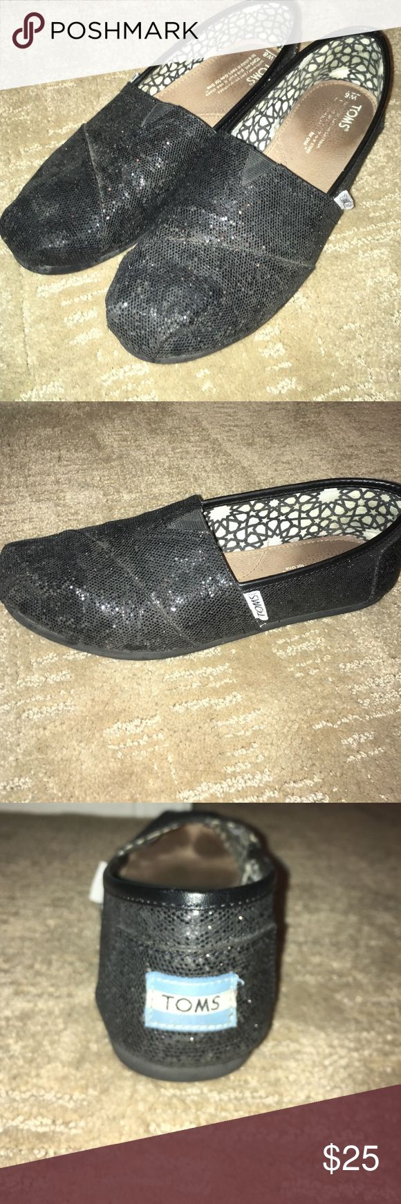 Black glitter TOMS classic slip ons Authentic black glitter TOM shoes, women's size 8. Previously loved, so it has some slightly worn spots but nothing too noticeable :) TOMS Shoes Flats & Loafers