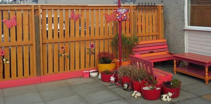 Bright garden! Loving how even on a dull day my garden feels sunny. Ronseal Golden Harvest fence paint. B&Q pomegranate coral and apricot garden paint.