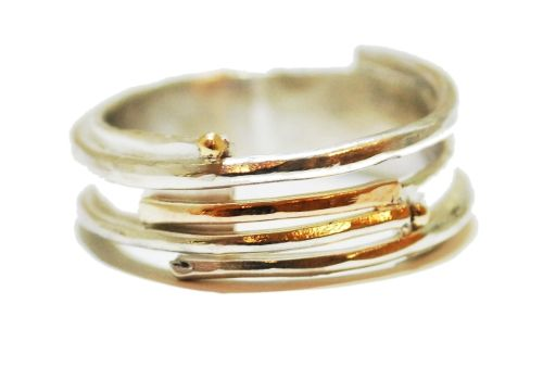 A unique silver ring with 9ct gold detail features four branches that curve around the finger. by Sunsanna Hanl #unusual #wedding #rings #London #Nude #Jewellery