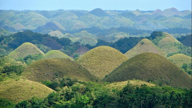 The Chocolate Hills are an unusual geological formation in Tagbilaran, Bohol, Philippines. According to a survey, there are 1,776 hills spread over an area of more than 20 sq. mi. covered by green grass that turns brown (resembling chocolates) during the dry season.