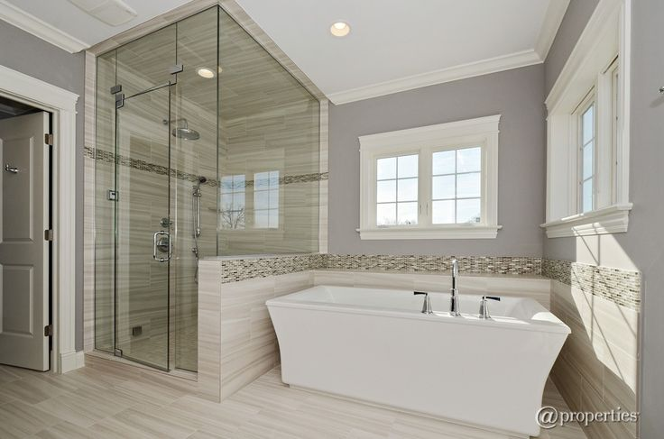 Contemporary Master Bathroom with Handheld showerhead, Freestanding, frameless shower door - looks peaceful