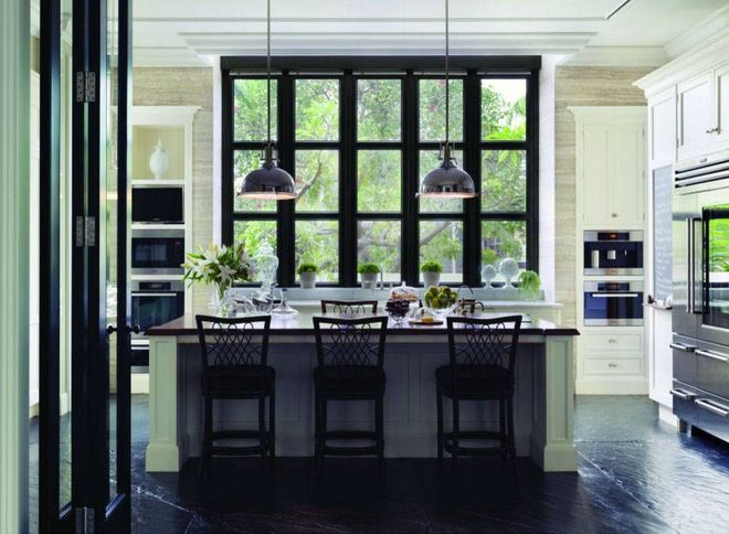 From Houzz.com Gorgeous island with all the black accent framing the outside greenery... Beautiful slate floors and light cabinets.